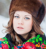 Beautiful girl in a fur hat Stock Photo