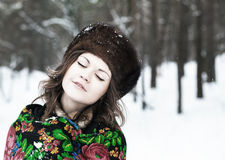 Beautiful girl in a fur hat Royalty Free Stock Image
