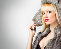 Beautiful girl in fur hat Stock Photo