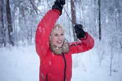 Beautiful girl in fur hat laughing Royalty Free Stock Images