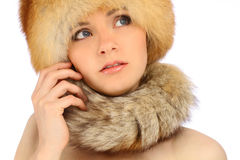 Beautiful girl in fur hat over white Stock Photos