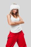Beautiful girl in a fur hat and a white T-shirt Royalty Free Stock Image