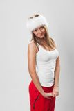 Beautiful girl in a fur hat and a white T-shirt Royalty Free Stock Photography