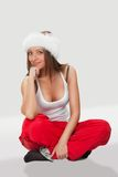 Beautiful girl in a fur hat and a white T-shirt Stock Images