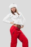 Beautiful girl in a fur hat and a white T-shirt Royalty Free Stock Images