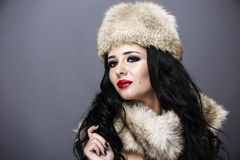 Beautiful Girl in Fur Hat. Winter Woman Portrait Stock Photography