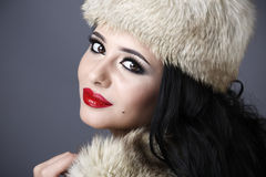 Beautiful Girl in Fur Hat. Winter Woman Portrait Royalty Free Stock Photography