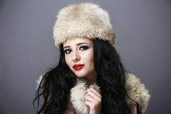 Beautiful Girl in Fur Hat. Winter Woman Portrait Stock Image