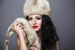Beautiful Girl in Fur Hat. Winter Woman Portrait Royalty Free Stock Image