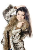 Beautiful girl in a fur hood Royalty Free Stock Photos