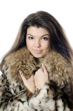 Beautiful girl in a fur hood Royalty Free Stock Image