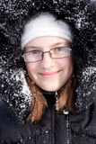 Beautiful girl in a fur hood in snow Royalty Free Stock Photography