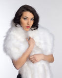 Beautiful girl in a fur shawl Stock Images