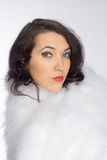 Beautiful girl in a fur shawl Stock Photo