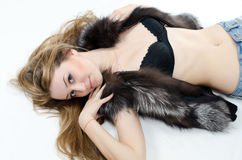 The beautiful girl in a fur vest Royalty Free Stock Photo