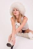Beautiful girl in furry hat. Studio shot royalty free stock photography
