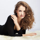 Beautiful girl on furs Royalty Free Stock Image