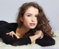 Beautiful girl on furs Stock Photography
