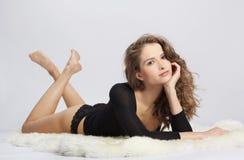 Beautiful girl on furs Stock Photos