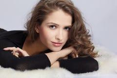 Beautiful girl on furs Royalty Free Stock Photo