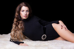 Beautiful girl on furs Stock Images