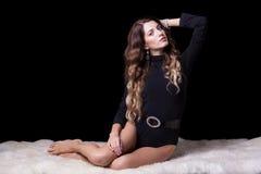 Beautiful girl on furs Royalty Free Stock Photos