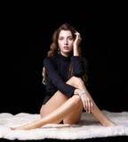 Beautiful girl on furs Stock Image