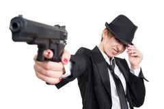 Beautiful girl gangster holding a gun. Classic Stock Photography