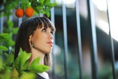 Beautiful girl in garden royalty free stock photography