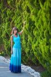 Beautiful girl in garden. Beautiful girl in green garden Stock Photo
