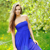 Beautiful girl in the garden on a sunny day Royalty Free Stock Photo
