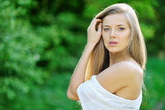 Beautiful girl in the garden on a sunny day Royalty Free Stock Image