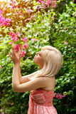 Beautiful girl in the garden with tropical flowers Royalty Free Stock Image