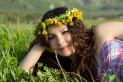 Beautiful girl with garlands on the grass Royalty Free Stock Photo