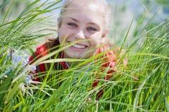 Beautiful girl gathering flowers. #5. Beautiful smiling girl gathering flowers. #5 royalty free stock photo