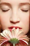 Beautiful girl with gerbera Royalty Free Stock Photos