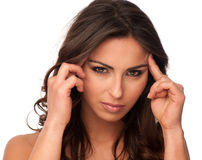 Beautiful girl gesturing headache Stock Images