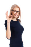 Beautiful girl gesturing OK Stock Photography