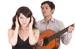 Beautiful girl gesturing silence while young man Stock Images