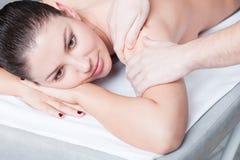 Beautiful girl getting a massage Stock Image