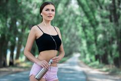 Beautiful girl getting ready for morning jogging. stock photography
