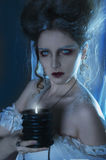 Beautiful girl ghost, witch, dead bride in a white dress with vi. Ntage hairstyle. Studio shot royalty free stock photo