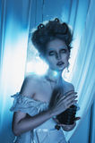 Beautiful girl ghost, witch, dead bride in a white dress with vi. Ntage hairstyle. Studio shot stock photography
