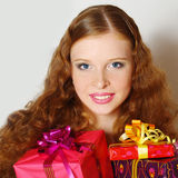 The beautiful  girl with a gift Stock Image