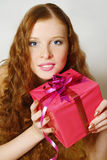 The beautiful  girl with a gift Stock Images