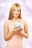 Beautiful girl with gift box Stock Photography