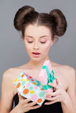 Beautiful Girl with Gift Royalty Free Stock Image