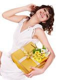 Beautiful girl with gift box and flower. Stock Photo
