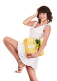Beautiful girl with gift box and flower. Royalty Free Stock Images