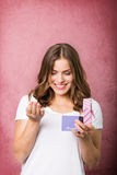 Beautiful girl with a gift box Stock Photos
